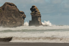 Crashing waves at Piha beach. New Zealand Stock Photos