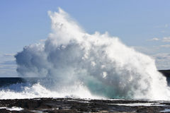 Crashing waves on rock ledge Royalty Free Stock Photography