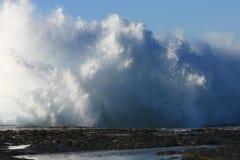 Crashing waves on rock ledge Royalty Free Stock Images