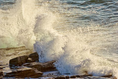 Crashing waves on rocks Stock Images