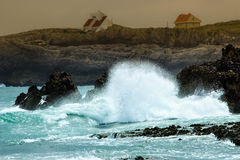 Crashing waves. Waves crashing on the rocks of a beach in Cantabria, Spain. Horizontal image Royalty Free Stock Images