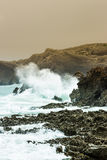 Crashing waves. Waves crashing on the rocks of a beach in Cantabria, Spain. Vertical  image Stock Photos