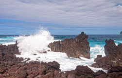 Crashing Waves on a Rocky Coast Stock Photos