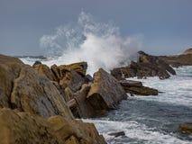 Crashing waves at rocky ocean cliffs Royalty Free Stock Photo