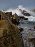 Crashing waves at rocky ocean cliffs Royalty Free Stock Photography