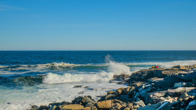 Crashing waves on a Rocky Shore Royalty Free Stock Images