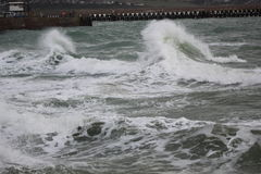 Crashing Waves. Waves rolling in at Newhaven, East Sussex Stock Photography