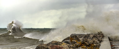 Crashing Waves on Shore of Lake Michigan. Large waves crashing against a rocky shore line in Milwaukee, WI Stock Photos