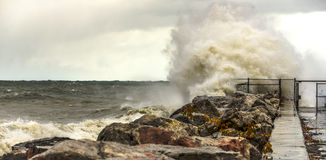 Crashing Waves on Shore of Lake Michigan. Large waves crashing against a rocky shore line in Milwaukee, WI Royalty Free Stock Photo