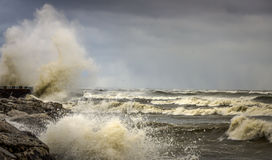 Crashing Waves on Shore of Lake Michigan. Large waves crashing against a rocky shore line in Milwaukee, WI Stock Image