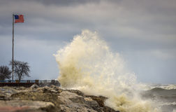 Crashing Waves on Shore of Lake Michigan. Large waves crashing against a rocky shore line in Milwaukee, WI Royalty Free Stock Photography