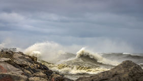 Crashing Waves on Shore of Lake Michigan. Large waves crashing against a rocky shore line in Milwaukee, WI Stock Images