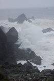 Crashing Waves in Storm. Waves crashing on rocks in a storm over the ocean stock images
