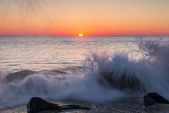 Crashing waves at Sunrise Stock Photo