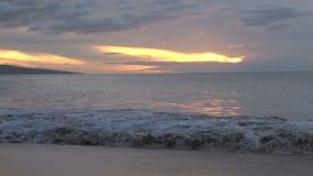 Crashing waves at sunset stock video