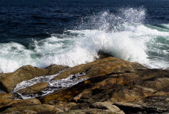 Crashing waves on volcanic rock Royalty Free Stock Image