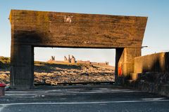 Craster Harbour framing Dunstanburgh Castle Royalty Free Stock Photography