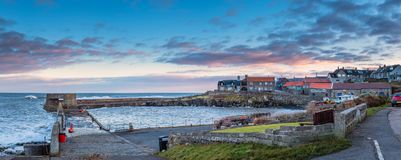Craster Harbour and Village Panorama Royalty Free Stock Photos