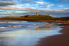 CRASTER, NORTHUMBERLAND/UK - AUGUST 20 : Sunset over Dunstanburgh Castle at Craster Northumberland on August 20, 2010 royalty free stock images