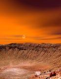Cratère de météore de lever de soleil Images libres de droits