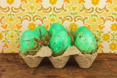 Crate with easter eggs on a wooden table stock photos