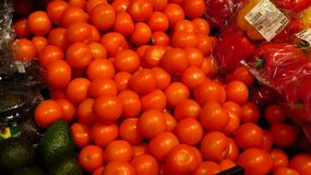 Tomatoes in Supermarket. Crate filled with tomatoes sold in a supermarket Stock Images