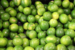 Crate of fresh,juicy limes at market Royalty Free Stock Image