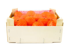 Crate with mandarins covered with a net Stock Image