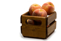 Crate of peaches on white Stock Photo