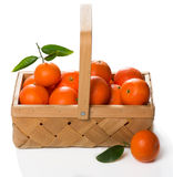 Crate of ripe tangerines with green  leaves Royalty Free Stock Photos