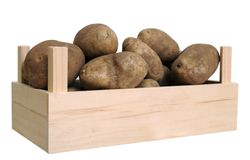 A crate with russet potato isolate on white Stock Image