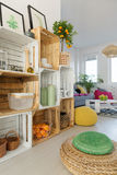 Crate shelf in apartment. Wood DIY crate shelf in colorful stylish apartment stock photo
