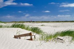 Crate washed ashore, lying on dune Stock Photos