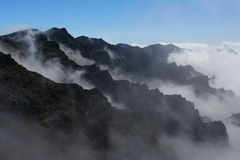 Crater in the Clouds. Clowdy crater of volcano Caldera di Taburiente, Canaries La Palma Stock Photos
