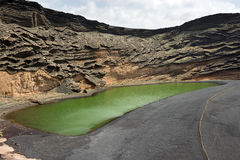 Crater and the green lagoon near El Golfo village, Lanzarote Canary Islands. The scenic view of green water due to algae which lives there, Spain stock images