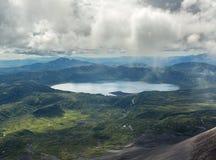 Crater Karymsky Lake. Kronotsky Nature Reserve on Kamchatka Peninsula. Royalty Free Stock Photos