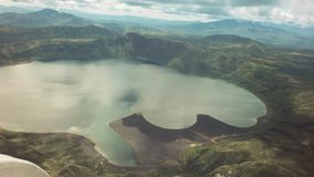 Crater Karymsky Lake. Kronotsky Nature Reserve. View from helicopter stock footage video stock video