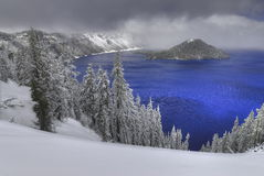 Crater Lake. This photograph of Crater Lake was captured in late spring 2007 during a snowstorm. Only a small part of the park was open for public due to heavy Royalty Free Stock Photography