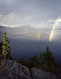 Crater Lake 5 Double Rainbow. Wizard Island and a double rainbow, photographed during a storm, in Oregon's Crater Lake National Park Stock Image
