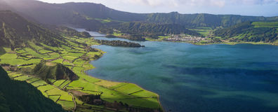 Crater lake in Azores. Crater volcanic lakes in Azores surrounded by green forest stock photos