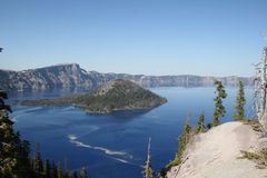 Crater Lake on a calm day. Crater Lake, in the National Park of the same name, on a cloudless, very still day, with scarcely a ripple in the waters of the lake Royalty Free Stock Photo