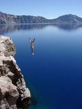 Crater Lake Leap. At nearly 2,000' deep, Crater Lake's azure blue waters are the deepest in North America. Despite a surface water temperature in the low 50's in Stock Photos