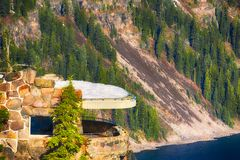 Crater Lake National Park Observation Deck. View of Crater Lake National Park observation deck perched along the steep slopes of the crater stock photo