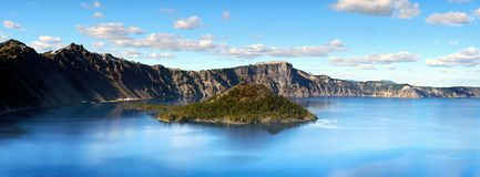 Crater Lake, National Park, Oregon United States. Blue Crater Lake - panoramic view from rim. National Park, Oregon. Crater Lake is the deepest lake in the royalty free stock image