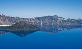 Crater Lake Oregon. Scenic view of cliffs or mountain range reflecting on Crater Lake, Crater Lake National Park, Oregon, U.S.A Stock Image
