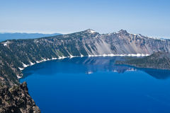 Crater Lake, Oregon. Crater Lake in Oregon with a perfect reflection on a calm sunny day Stock Photo