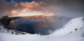 Crater lake partialy foggy. The panoramic view of Crater Lake in partial fog after snow storm royalty free stock images