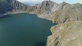 Crater Lake Pinatubo, Philippines, Luzon. Lake high in the mountains, aerial view. Beautiful mountain landscape with. Peaks of mountains and volcanoes. Mountain stock footage