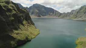 Crater Lake Pinatubo, Philippines, Luzon. Lake high in the mountains, aerial view. Beautiful mountain landscape with. Peaks of mountains and volcanoes. Mountain stock video footage