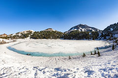 Crater lake with snow on Mount Lassen in the Lassen volcanic nat Stock Photos